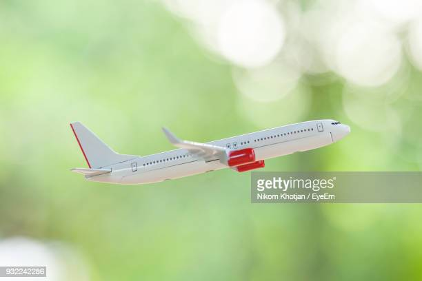 Close-Up Of Model Airplane Flying Outdoors