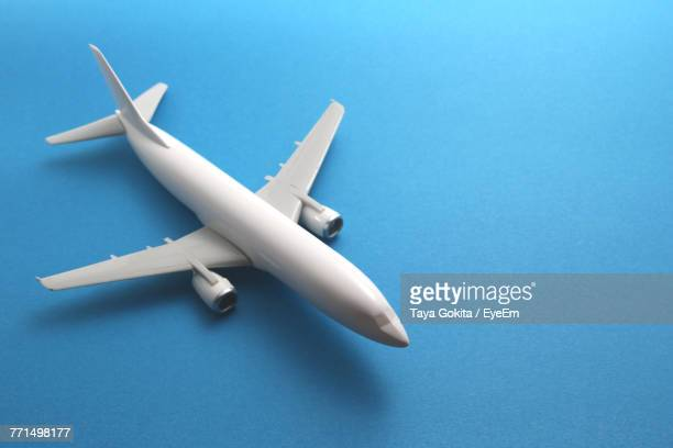 Close-Up Of Model Airplane Over Blue Background
