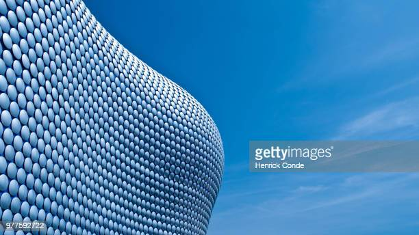 close-up of modern building against blue sky, birmingham, usa - birmingham england stock pictures, royalty-free photos & images