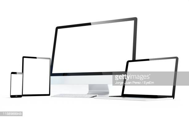 close-up of modern technologies against white background - tablet pc stockfoto's en -beelden