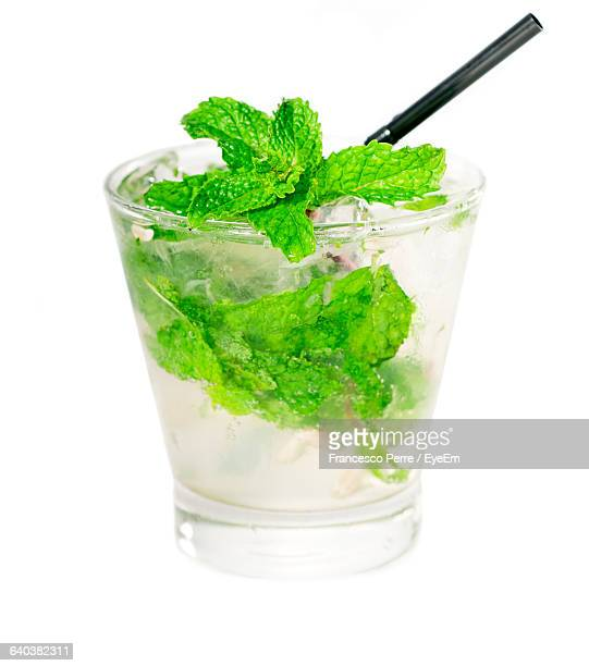 Close-Up Of Mojito Cocktail With Fresh Mint Against White Background