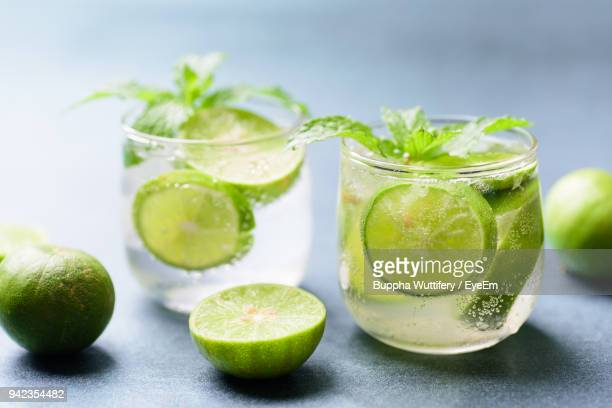 close-up of mojito in glasses on table - mojito stock photos and pictures