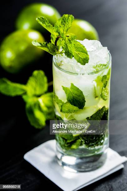 close-up of mojito on table - mojito stock photos and pictures