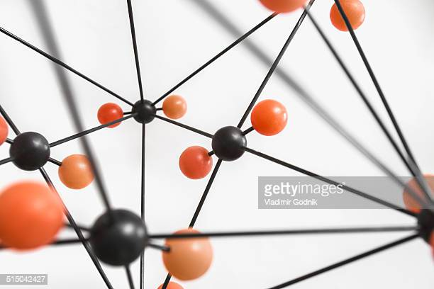 Close-up of molecular structure over white background