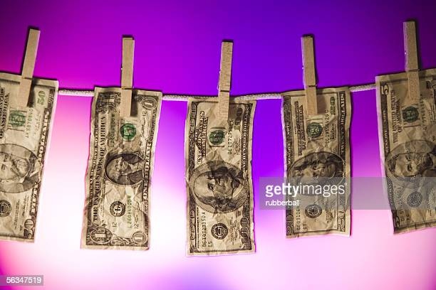 Close-up of money hanging on a clothes line