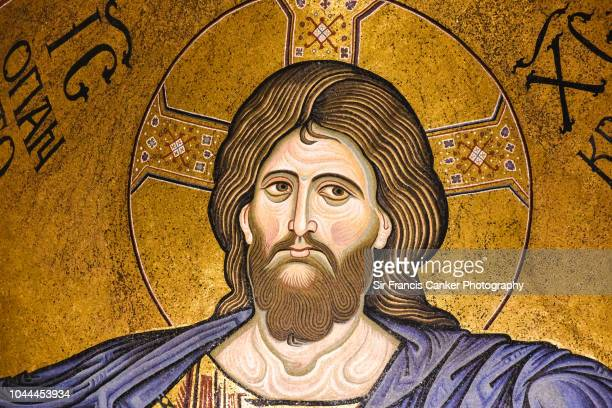 close-up of monreale cathedral with prominent christ pantocrator mosaic in the apse at palermo, sicily, italy - jesus christ photos stock pictures, royalty-free photos & images