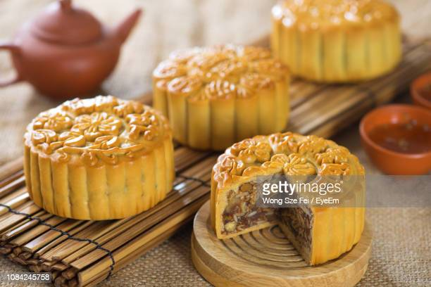 close-up of moon cake on table - moon cake stock pictures, royalty-free photos & images
