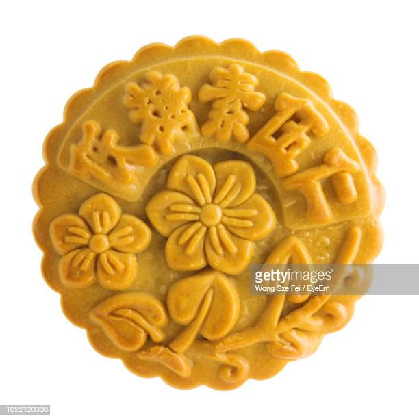 close-up of moon cake over white background - moon cake stock pictures, royalty-free photos & images