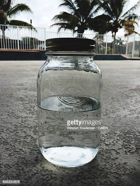 close-up of moonshine alcohol in glass jar - 密造酒 ストックフォトと画像
