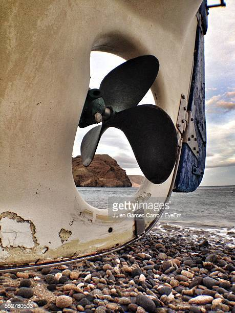 Close-Up Of Moored Boat Propeller At Beach