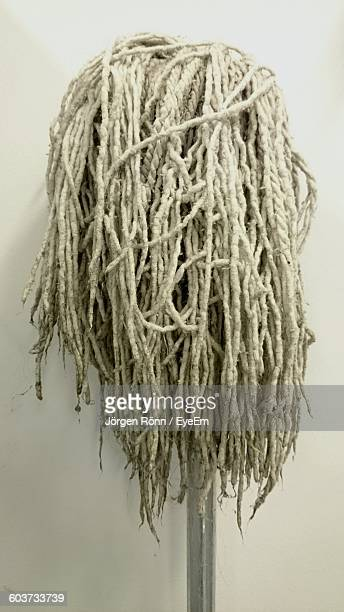 Close-Up Of Mop Against Wall