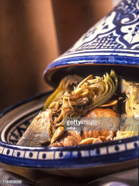 close-up of moroccan tajine with chicken, artichoke and nuts. - couscous stock pictures, royalty-free photos & images