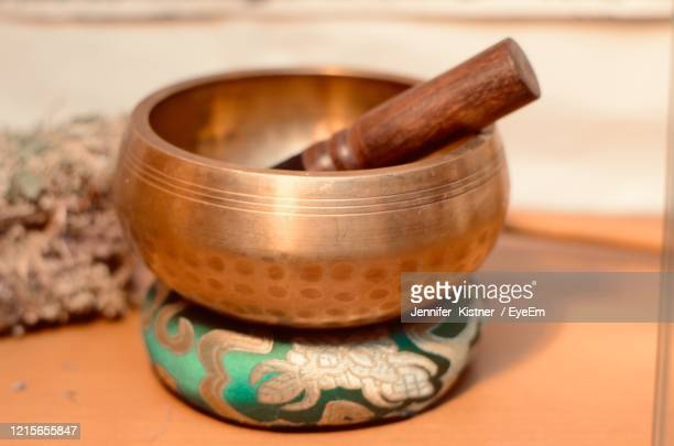 close-up of mortar and pestle on table - rin gong stock pictures, royalty-free photos & images