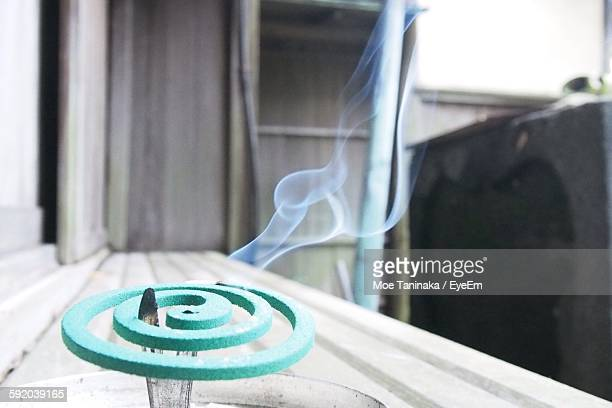 Close-Up Of Mosquito Coil On Window Sill