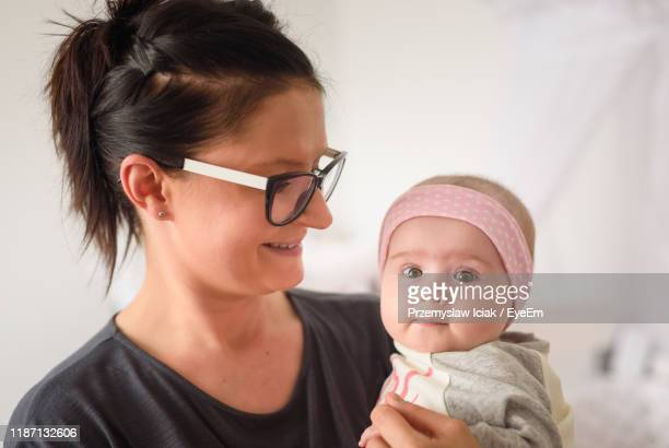close-up of mother and daughter at home - hazel bond stock photos and pictures