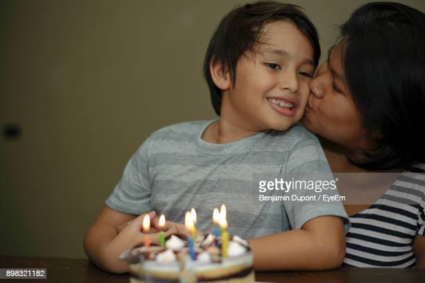 Close-Up Of Mother Kissing Son During Birthday