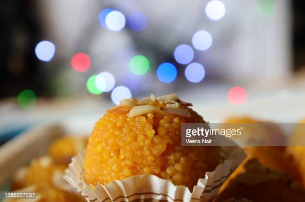close-up of motichoor ladoo/laddu against fairy lights/bokeh-diwali festival/india - ahmedabad stock pictures, royalty-free photos & images