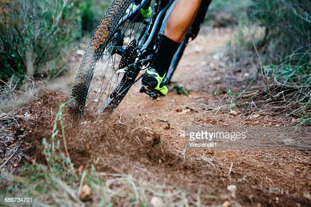 Close-up of mountainbiker skidding in a curve