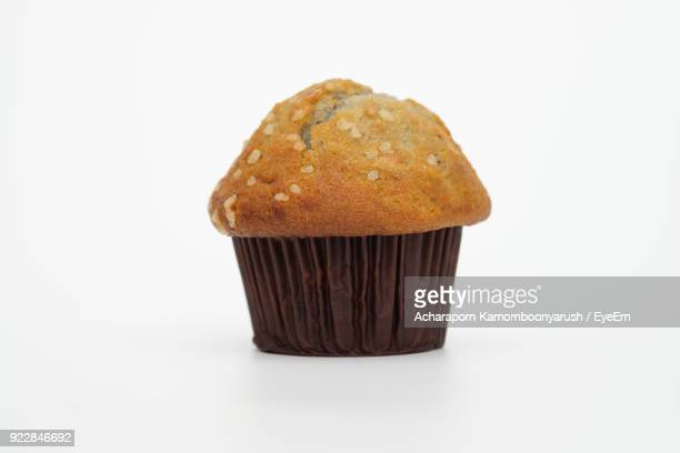 Close-Up Of Muffin Against White Background
