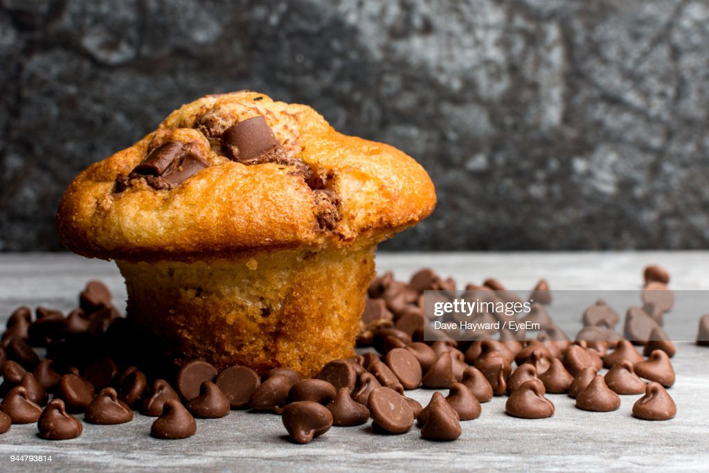 Close-Up Of Muffin With Chocolate Chips On Table : Stock Photo