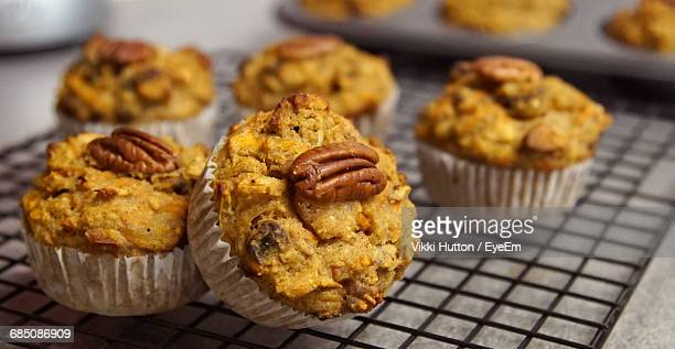 close-up of muffins on cooling rack - hutton stock photos and pictures