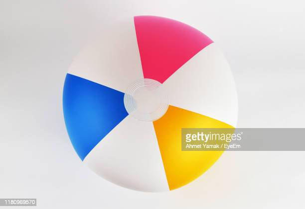 close-up of multi colored ball against white background - ビーチボール ストックフォトと画像