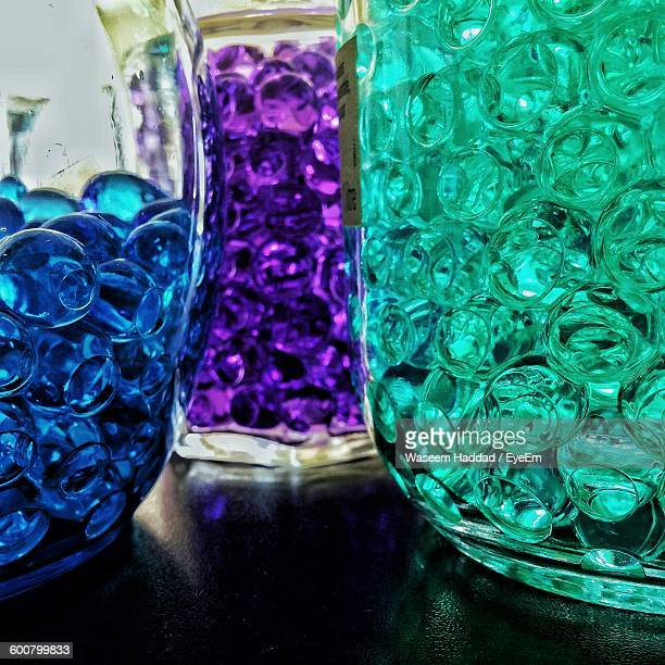 Close-Up Of Multi Colored Beads In Glass Bottle