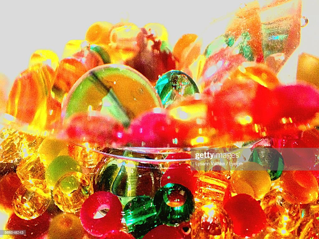 Close-Up Of Multi Colored Beads In Glass Bowl : Stock Photo