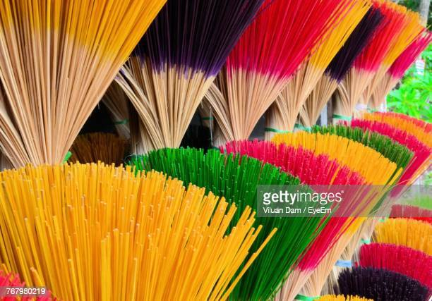 Close-Up Of Multi Colored Brooms