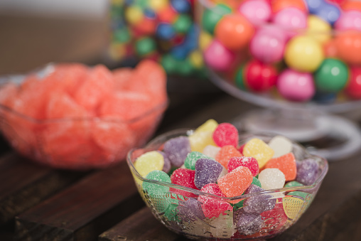 Close-Up Of Multi Colored Candies On Table - gettyimageskorea