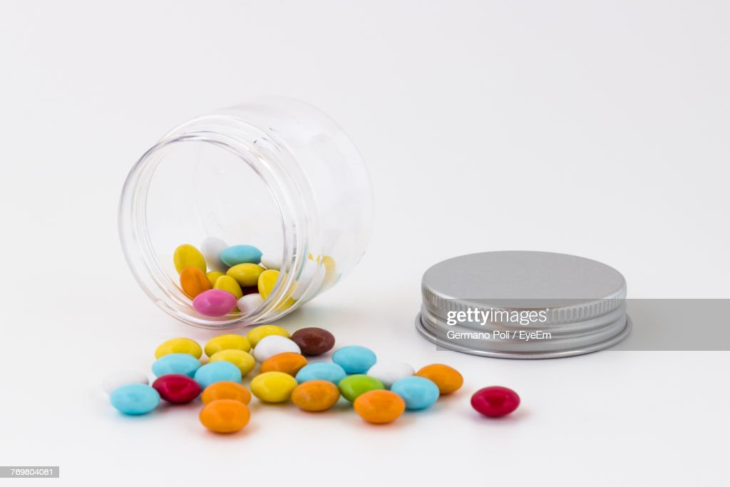 Close-Up Of Multi Colored Candies Over White Background : Stock Photo