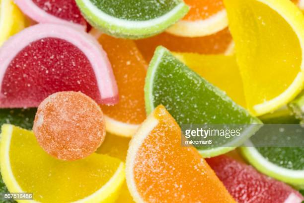 close-up of multi colored candies, rainbow jello , homemade dessert. - sugar food stock pictures, royalty-free photos & images