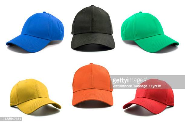 close-up of multi colored caps against white background - pet stockfoto's en -beelden