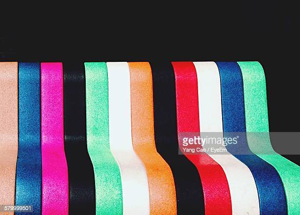 Close-Up Of Multi Colored Chair Against Black Background