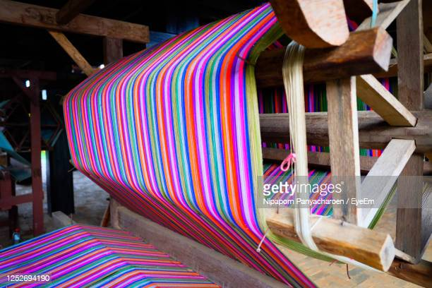 close-up of multi colored chairs - loom stock pictures, royalty-free photos & images