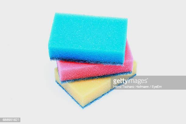 Close-Up Of Multi Colored Cleaning Sponge Against White Background
