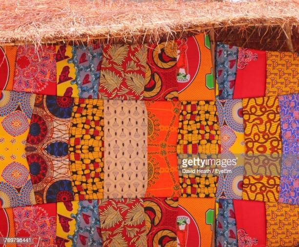 close-up of multi colored clothes hanging for sale - malawi stock pictures, royalty-free photos & images