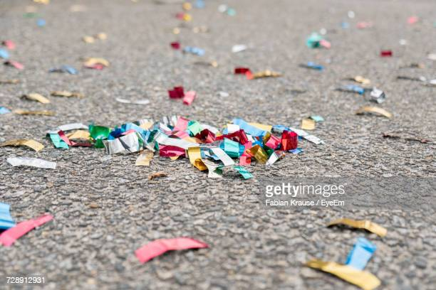 Close-Up Of Multi Colored Confetti On Street
