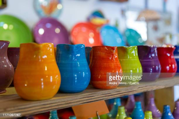 close-up of multi colored containers in store - andre wilms eyeem stock-fotos und bilder