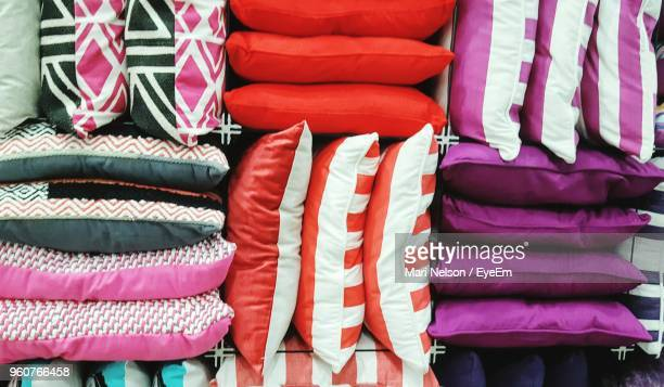 close-up of multi colored cushions at store for sale - cushion stock photos and pictures
