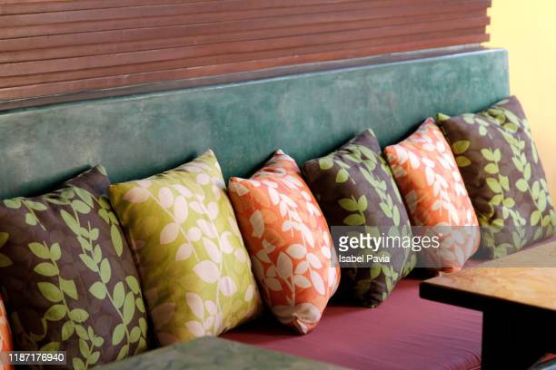 close-up of multi colored cushions on sofa at home - cushion stock pictures, royalty-free photos & images