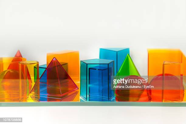 close-up of multi colored decorations against white background - translucent stock pictures, royalty-free photos & images