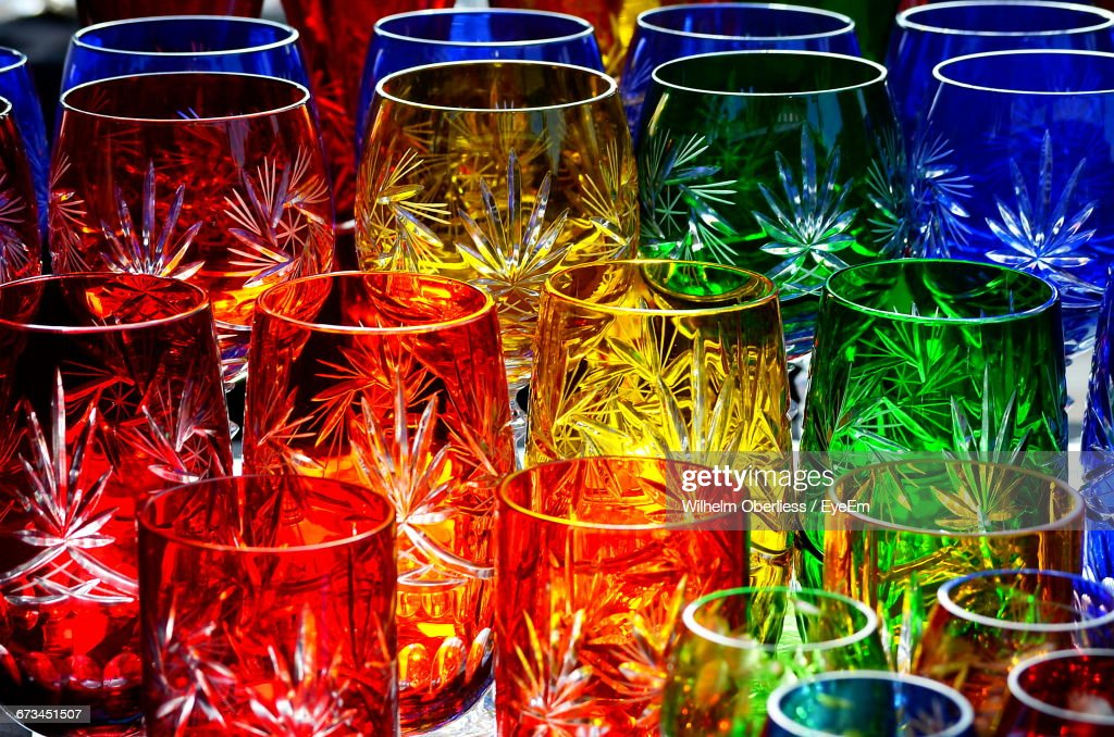 Close-Up Of Multi Colored Drinking Glasses On Table : ストックフォト
