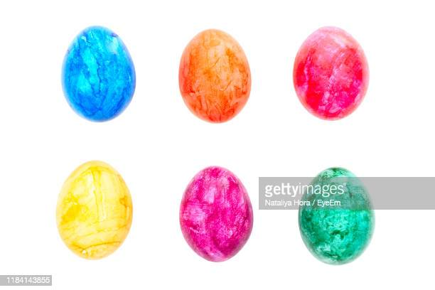 close-up of multi colored easter eggs against white background - easter egg stock pictures, royalty-free photos & images