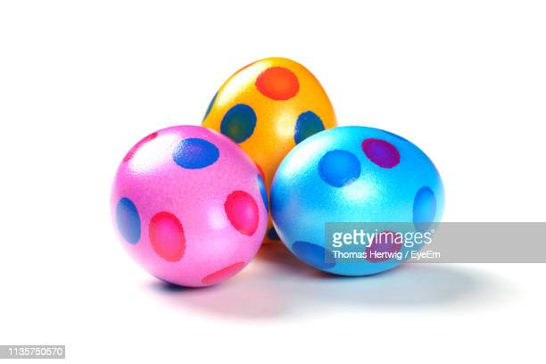 close-up of multi colored easter eggs over white background - osterei stock-fotos und bilder
