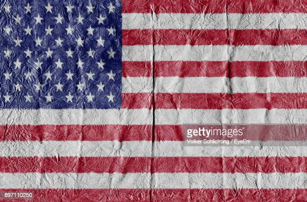 Close-Up Of Multi Colored Flag Painted On Wall