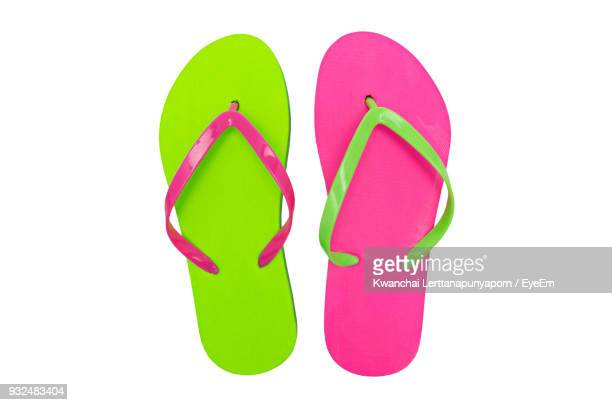 close-up of multi colored flip-flop on table - sandal stock pictures, royalty-free photos & images