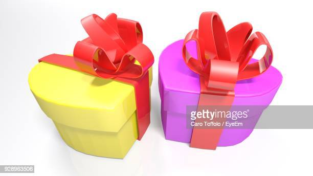 Gift box illustration getty images close up of multi colored gift boxes over white background negle Gallery