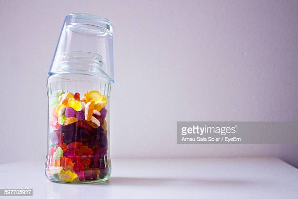 Close-Up Of Multi Colored Gummy Candies In Glass Jar