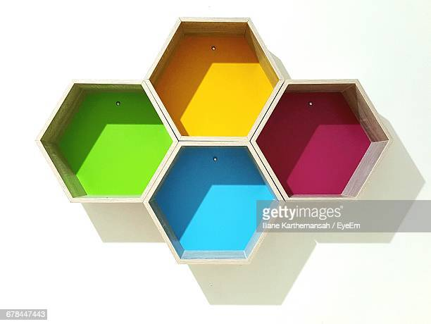 Close-Up Of Multi Colored Hexagon Shapes Mounted On Wall